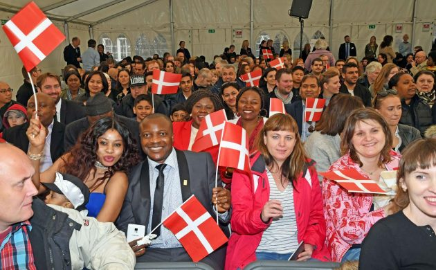 New Danes celebrate upon receiving their passport.